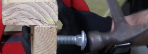 Hammer the carriage bolt washer into a hole